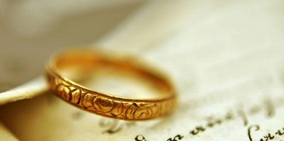 Gold wedding ring in Bible