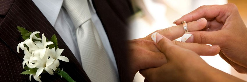 Bride and groom exchange rings during their wedding