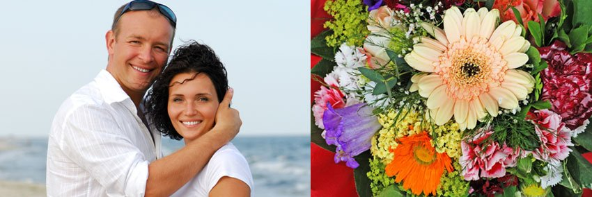 Couple on the beach with wildflower bouquet